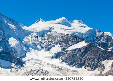 Close view of the Piz Bellavista from Diavolezza on a sunny day. It is a mountain of Bernina massiv in the Eastern Alps and located in swiss Canton of Grisons, Switzerland.