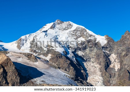 Close view of the Piz Bernina from Diavolezza on a sunny day. It is the  the highest mountain in the Eastern Alps and in swiss Canton of Grisons, Switzerland.