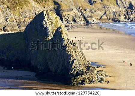 Close view of Three Cliffs bay on the Gower peninsular with heavy shadow