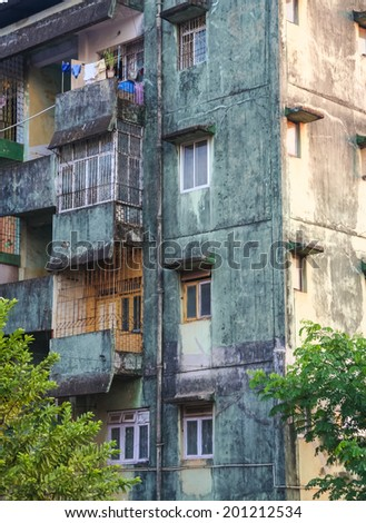 Close view of worn apartment building - stock photo