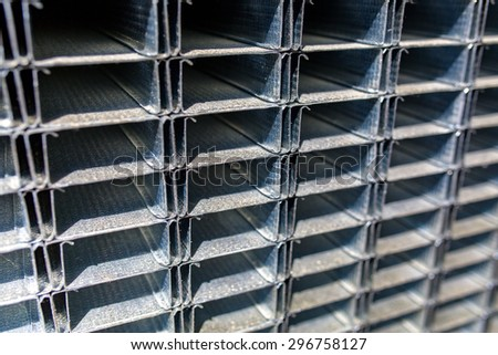 Close view on the steels profiles on a stack