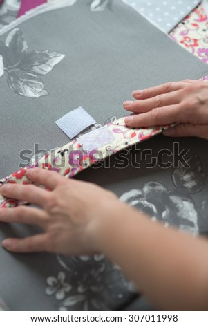 close woman hands sewing