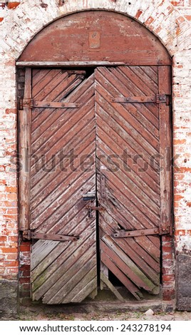 Closed big old door with rusty key with clipping path - stock photo