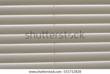 closed blinds on the window as a background
