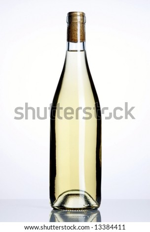 Closed bottle of white wine on white background - stock photo