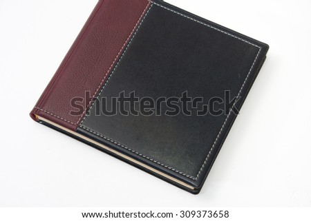 Closed business leather agenda on the white background.