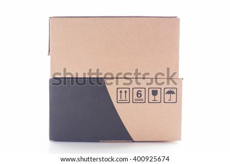 Closed cardboard box on white background. - stock photo