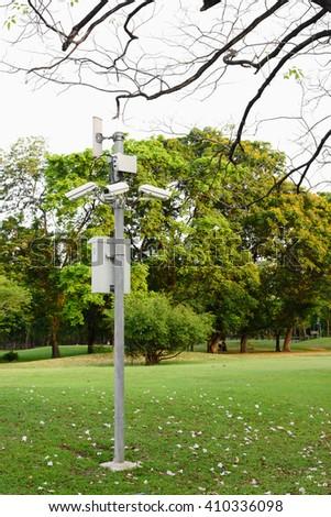 Closed circuit camera in park - stock photo