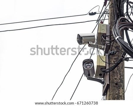 Closed Circuit Television On Electric Pole White Background