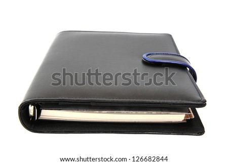 Closed dairy book and notebook isolated on white background - stock photo