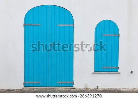 closed door and window on the street - stock photo