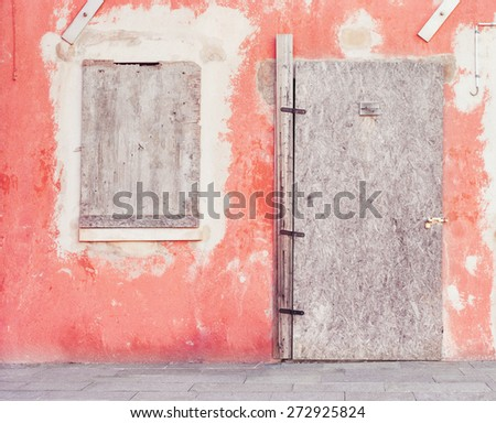 Closed door of abandoned house in Venice, Italy. - stock photo