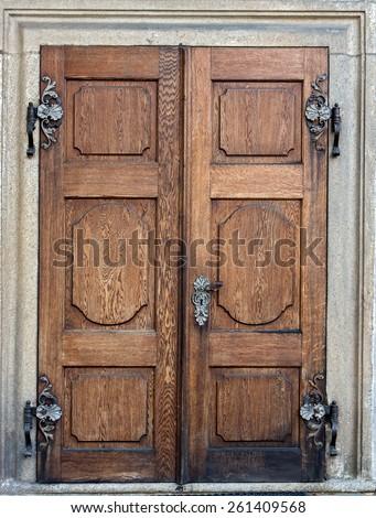 Closed doors at the Castle Czech Krumlov. Old wooden decorative door. Historical door with decorative ironwork to the castle Cesky Krumlov, Czech republic. - stock photo