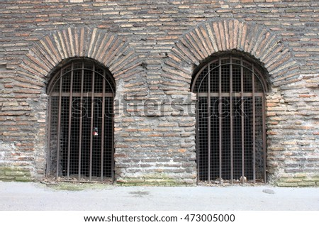 Closed doors of a prison with bars