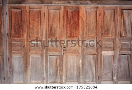 Closed doorway Old wooden door background - stock photo