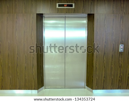 Closed elevator door on ground floor.