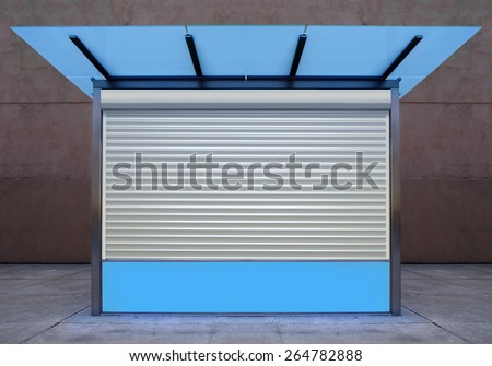 closed empty news stall on street of city at night time - stock photo