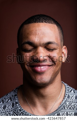 closed eyes portrait of an afroamerican man smiling