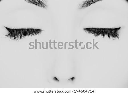 closed eyes with long eyelashes - stock photo