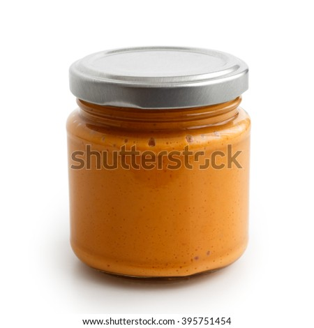 Closed glass jar of tomato and red chilli pepper salsa. Isolated in low perspective on white.