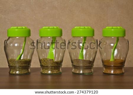 Closed glass jars kitchen storage spices - stock photo