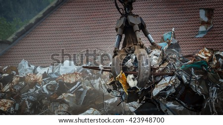 Closed grapple loader detail, manipulating with metal waste - scrap. - stock photo