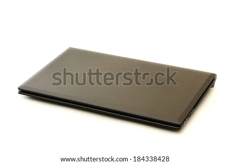 Closed laptop computer isolated on a white background