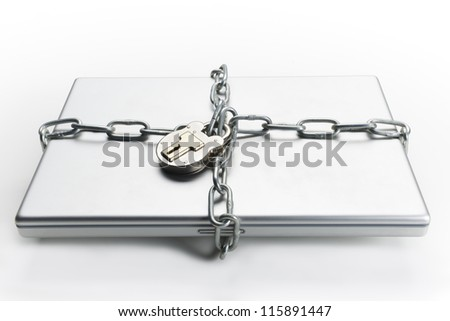 Closed laptop computer with chain wrapped around it and padlocked