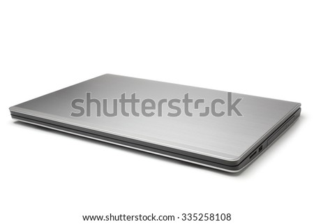 Closed laptop on white background - stock photo