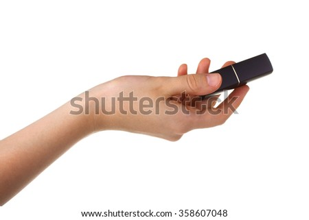 closed lipstick in a woman's hand isolated on white background - stock photo