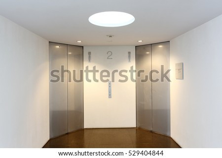 Closed modern metal elevator doors in a hall