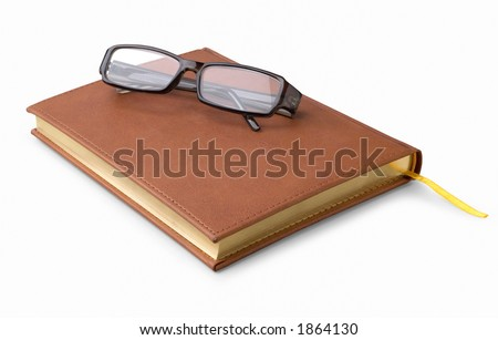 Closed Note-book and glasses with clipping path included