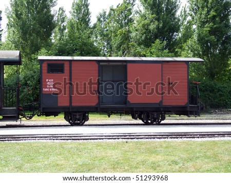 Closed old freight car of the railway