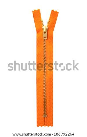 Closed orange zipper isolated over white - stock photo