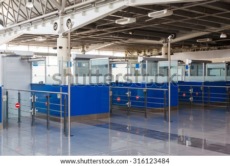 closed rack passport control the border state in the airport - stock photo