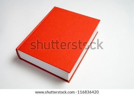 Closed red book on white background