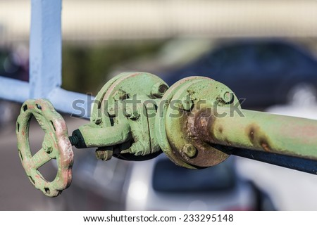 Closed, rusty old valve - stock photo
