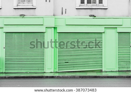 Closed shutters on the front of a shop in the UK
