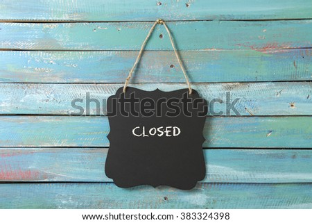 closed sign hanging on blue background - stock photo