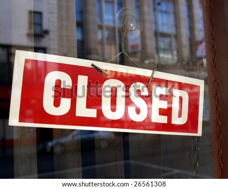 Closed sign in a shop showroom with reflections - stock photo