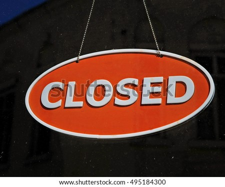 Closed sign on the dark background