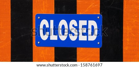 Closed Sign with reflective orange and black stripes