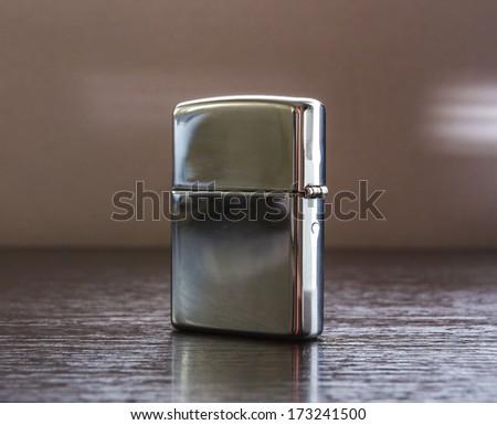 Closed Silver Cigarette Lighter - stock photo