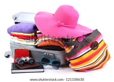 Closed silver suitcase with clothing isolated on white - stock photo