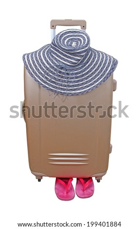 Closed suitcase ready for summer vacation with hat and flip flops isolated with clipping path included - stock photo