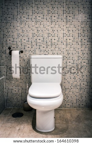 Closed toilet - stock photo