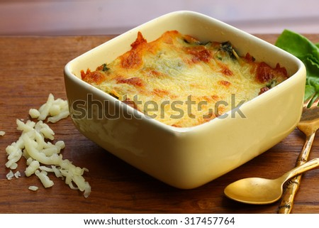 Closed up Baked spinach with cheese. - stock photo