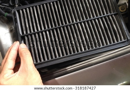 Closed up change air filter in car