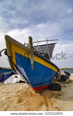 closed up fisherman boat stranded on the sandy beach and cloudy sky at sunny day.