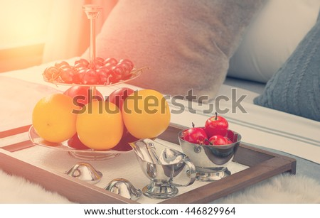 closed up fruits on wooden tray in bed at the hotel - stock photo